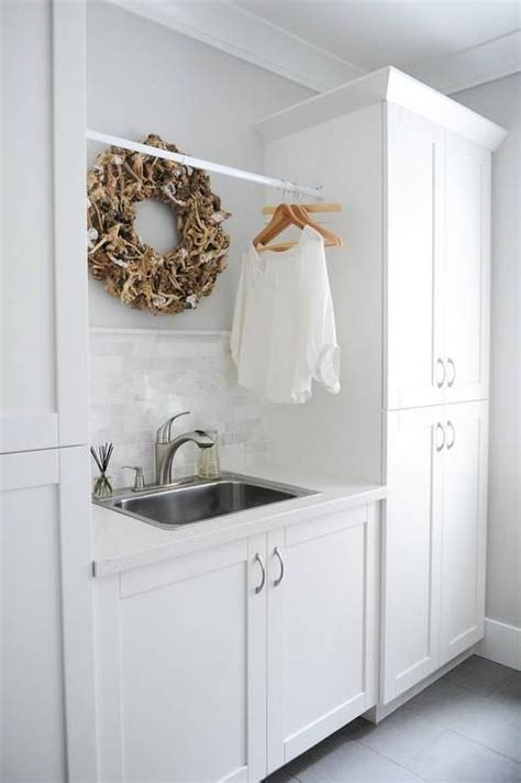small tension rods for cabinets white and gray laundry room features a stainless steel