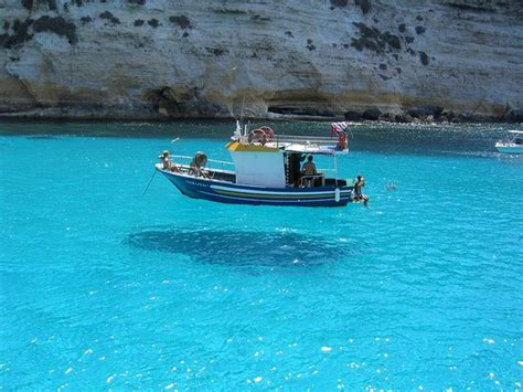 boat floating on air isola di ledusa italy looks like boat is floating in