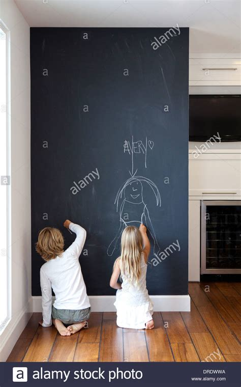 chalkboard paint concepts when writing kids writing on chalkboard wall stock photo royalty free