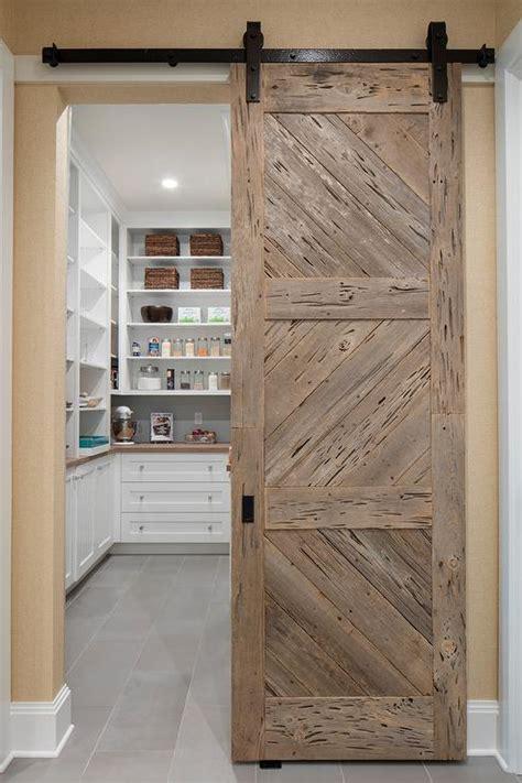 white pecky cypress kitchen cabinets  navy blue island
