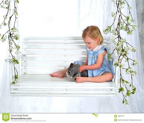 bunny swing girl holding bunny on swing stock photos image 4864773