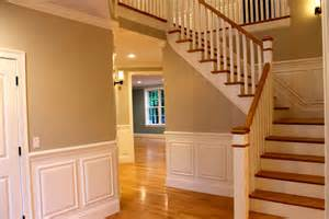 Red oak floor in staircase traditional with open foyer hallway with