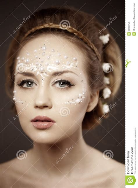 creative in make up but what we see in these hot girls wallpaper woman with creative make up of pearls stock photo image