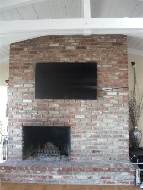 how to hide tv wires brick fireplace we are looking for any ideas on how to resurface the brick