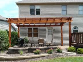 pergola over patio covers only half of flat back facade