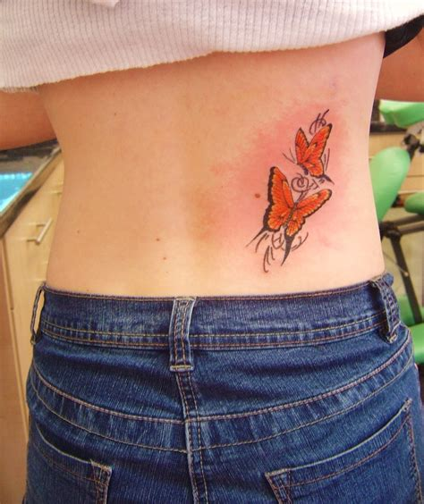 tattoos on waistline designs waist tattoos designs pictures