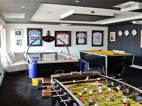 air hockey soccer table room with pool table table football and air hockey