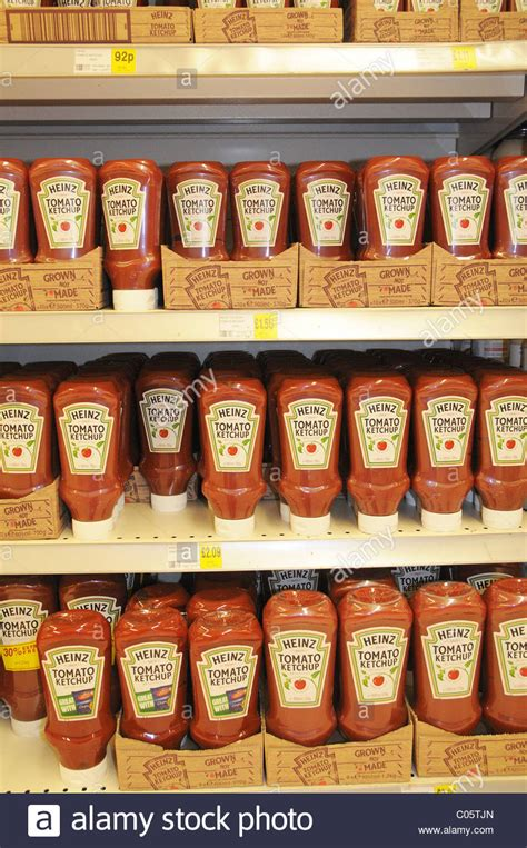 bottles of heinz tomato ketchup on a shelf in a