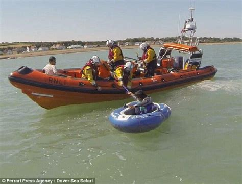 inflatable dinghy lifeboat illegal immigrants caught heading for uk in toy dinghy