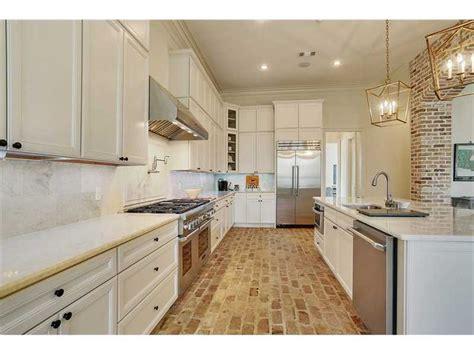 white kitchen  chicago brick floors white kitchen