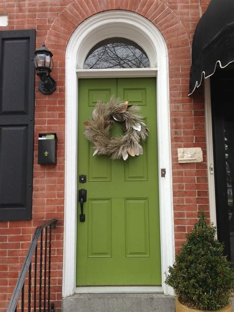 green front door brick black shutters and green door still like this