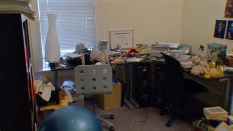a cluttered home office the live well network