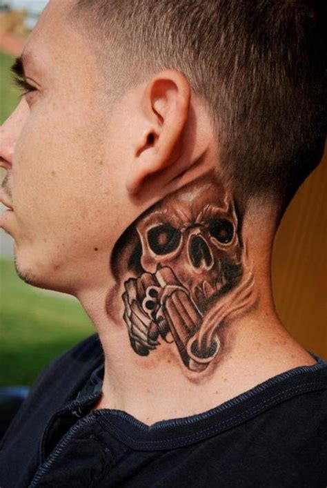 grey ink skull tattoo on side neck