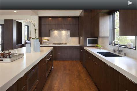 White quartz countertop with dark cabinets. Modern. The