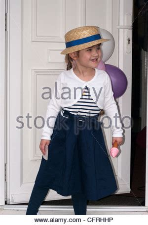 girl wearing  pretty dress climbing  stairs