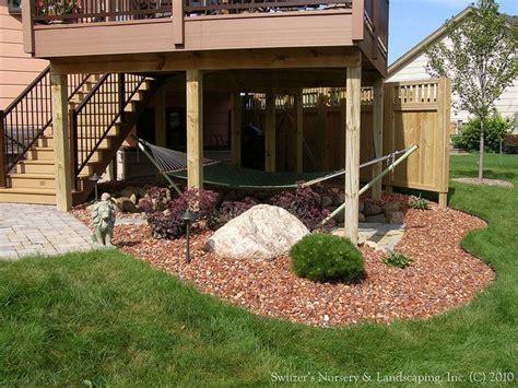 an outdoor living bonus room using the space below