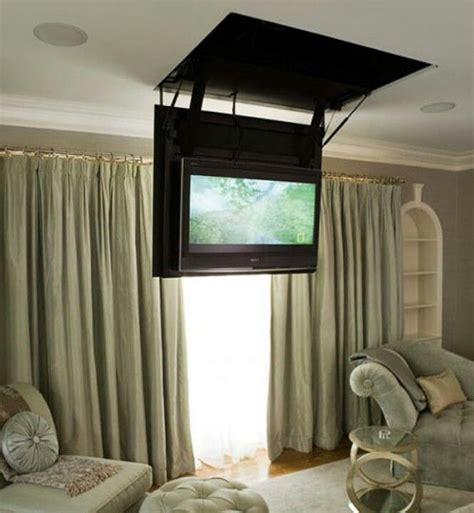 hidden tv from the ceiling hide the blasted t v
