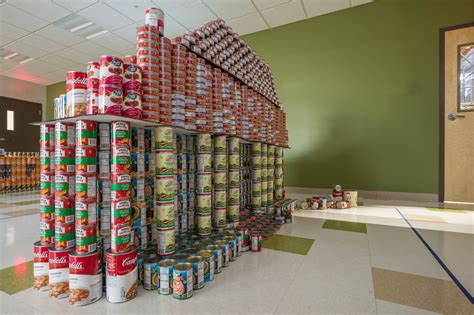 canstruction students design and build colossal canstruction raises nearly 12 000 cans of food for