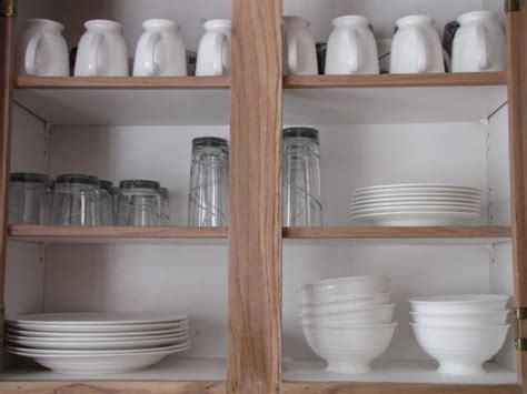 how to put in kitchen cabinets where to put dishes in kitchen cabinets roselawnlutheran