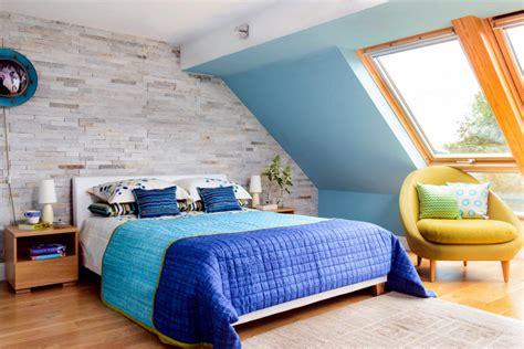 yellow armchair in blue bedroom interior design ideas