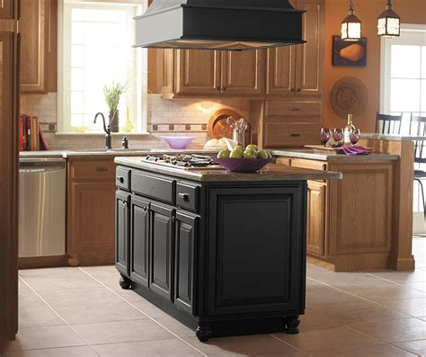 kitchen with light oak cabinets light oak cabinets with a black kitchen island masterbrand