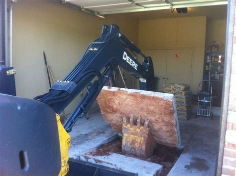 F5 Storm Shelter installers removing the concrete slab