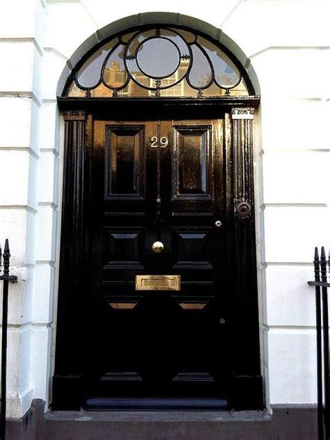 shiny black door   gorgeous window  black