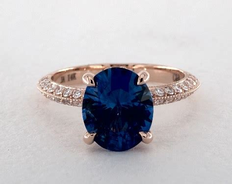 2 49 carat blue sapphire oval cut pave engagement ring in