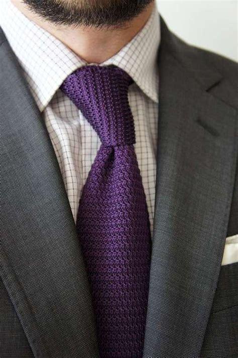 grey suit white shirt with black checks purple knit