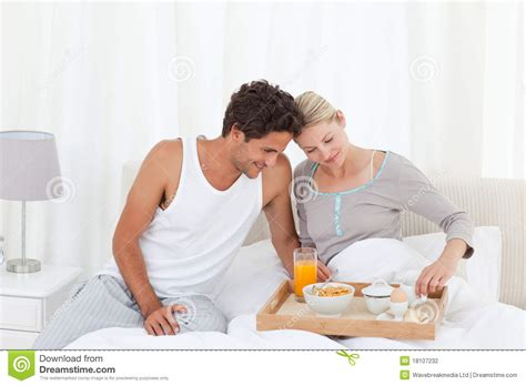 lovers in bed lovers having breakfast at bed stock photography image
