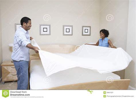couple bed sheets couple arranging bedsheet stock image image of bedsheet