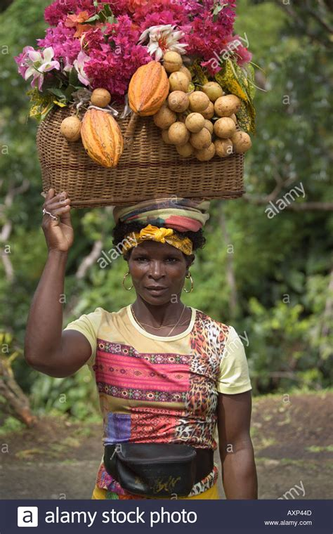 woman with fruit basket on head woman carrying baskets of fruit on her head grenada