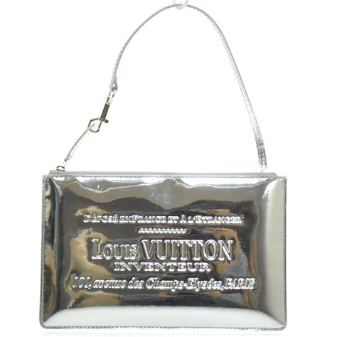 Visionaire Gets Wonkafied By Louis Vuittons Miroir by Louis Vuitton Mirror Miroir Inventeur Pochette Plat Silver