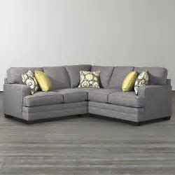 Small Grey L Shaped Couch With Arms And Wooden Legs For Living Room Spaces With Hardwood Floor
