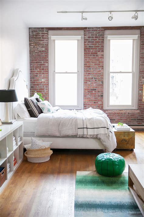 exposed brick bedroom home tour a style blogger s laid back seattle loft white bedding bricks and bright