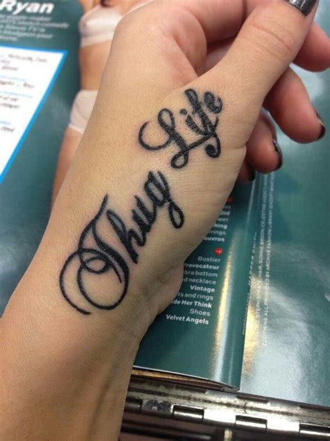 alphabet tattoo on hand classic thug life lettering tattoo on girl both hand fingers