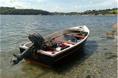row boat with motor rental cottage comes with a fishing boat and outboard