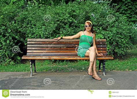 sitting on bench woman sitting alone on bench stock image image 10341521
