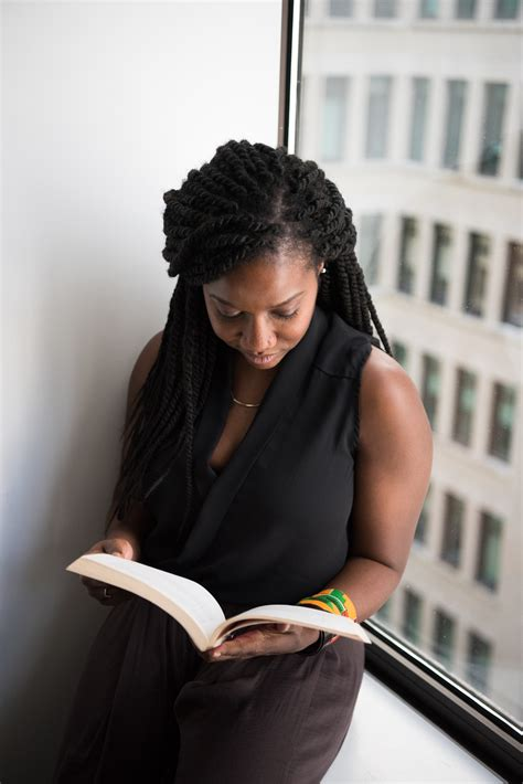 women reading  book   tree  stock photo