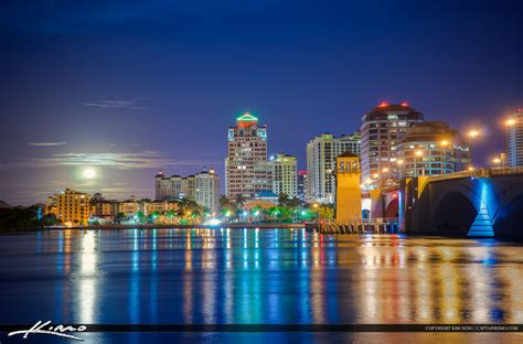 boat cruise west palm beach west palm beach skyline moon setting over waterway