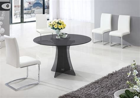 dining table in smoked glass and 6 white chairs