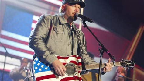 semper fi tattooed on his left arm toby keith made in america country rebel