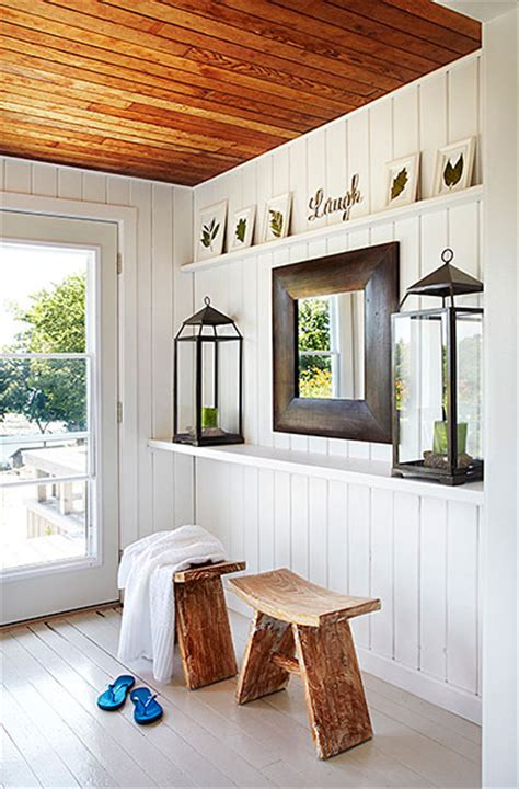paint wood paneling white white painted floor cottage entrance foyer laura hay