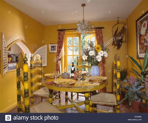 yellow dining room table painted yellow chairs and table in bright yellow dining