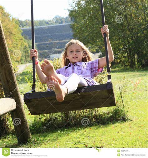kid on swing kid girl on swing stock image image of happiness feet