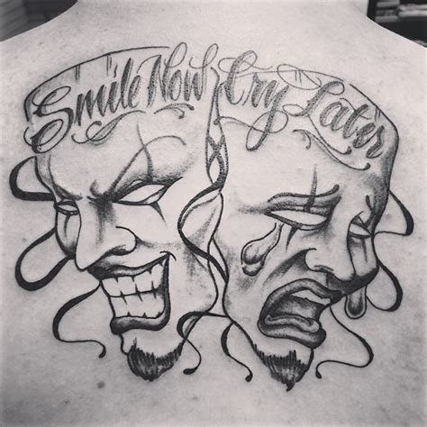 laugh now cry later masks tattoo image real photo