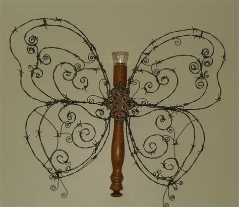 hometalk barbed wire wall butterfly craft