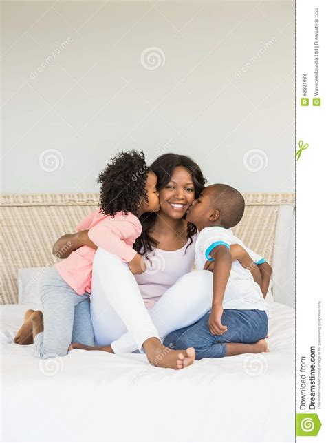kissing games on the bed children kissing mother on bed stock photo image 62321988