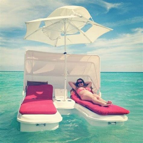 Floating Lounge Chair With Umbrella by Floating Lounge Chairs W Umbrella I Think Yes For The