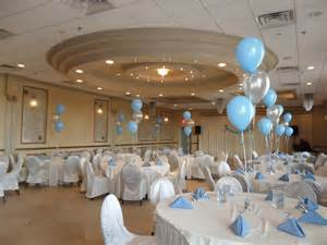 Blue and silver balloons to decorate a little boy s baptism party